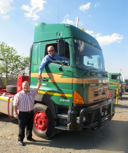 Sampie Swanepoel, CEO of Transvaal Heavy Transport, welcomes Ernie Trautmann, the truck-driving Hino SA vice president, to the main depot of THT in Alrode as 'driver Trautmann' delivers one of two 6x4 700-Series 2848 truck-tractors – the latest additions to the THT fleet.
