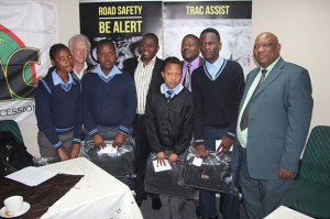 "The four students receive their bursaries from TRAC. ""We would like to see you take this opportunity to become somebody great in our society,"" said Graham Esterhuysen, CEO of TRAC, at the handover ceremony."