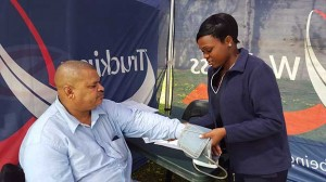 Truck driver Andres Carolissen of Benjanim Gus Services about to have his blood pressure tested by health care worker Talent Xulu. More and more truck drivers are presenting themselves for health screening.