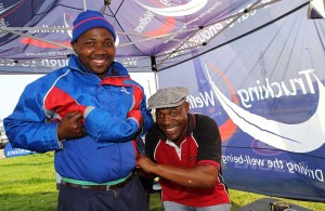 Buyisiwe Jubase of Engen (left) gets his waist measured by Stephan Mokhesi, a councillor from Corridor Empowerment project ( CEP ) at a truck stop in East London.