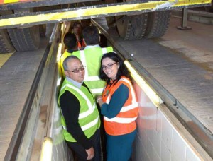Toni Fritz (right), head of Vehicle and Asset Finance, Business and Commercial at Standard Bank, gets down and under at a <em>FleetWatch Brake & Tyre Watch</em> event.