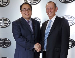 Zhijian Wang (left), managing director of FAW Import & Export Co Ltd and Manuel Pereira de Canha, CEO of Associated Motor Holdings, shake on the deal whereby AMH will now be the exclusive sales, parts, service and maintenance truck partner of FAW in Zambia and in Malawi.