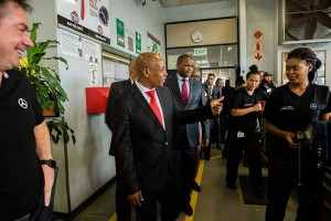 Dignitaries talking to learners during the tour of the facility.