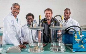 Lindokuhle Mahlangeni (second from left) and Sandiswa Jekwa (right) both candidates at SANRAL'S Centre of Excellence with senior laboratory manager Jeremy Dick (left) and Sean Strydom, SANRAL'S material lab technician, busy working with a water sorptivity device which tests the durability of concrete structures in harsh and aggressive environments.