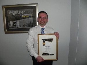 Manoel Almeida, Group Finance Director for Goodyear receiving award for being recognized as a Top 50 company by Nelson Mandela Bay Municipality.