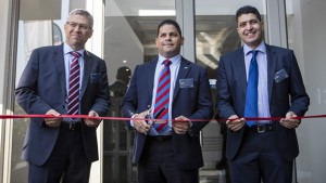 Cutting the ribbon to a fresh start for MAN Truck & Bus South Africa are, from left: Markus Geyer, managing director; Ian Seethal, head of network development and head of marketing communications (South Africa and Sub-Equatorial Africa) and Arshad Hassim, financial director.