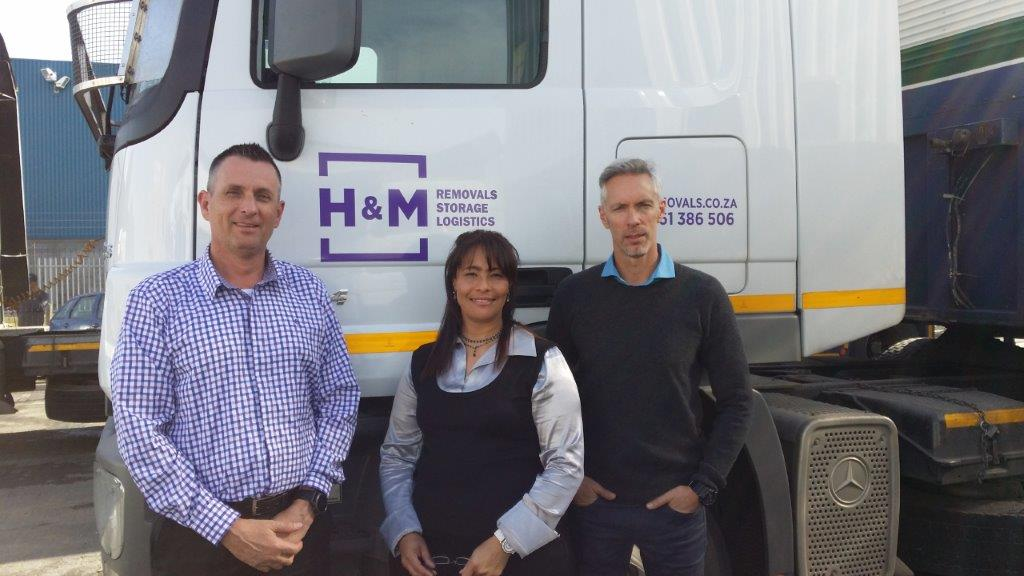 Happy with the multiple benefits achieved through the fleet management solution implemented by MiX Telematics in co-operation with its Cape Town based channel partner, Tectra Telematics, are, from left: Anthony Healey, MD of H&M Removals; Angela Julies, fleet controller; and James Campbell-Miller, sales director.