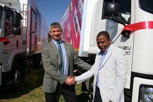 Tobie Krige, managing director of distribution at Adcock Ingram, congratulates Daniel Moloi, one of the owner drivers, on receiving the additional vehicle for his fleet. A total of 19 owner driver entrepreneurs are now contracted to Adcock Ingram's distribution service.