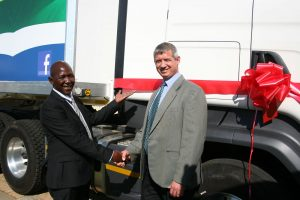 "A delighted Meshack Matswi, one of the owner driver recipients, being congratulated by Tobie Krige, managing director of distribution at Adcock Ingram. ""I am fortunate that my business success has enabled me to build a three bedroomed home and has given my family the financial security that allows us to live happily and without stress,"" says Matswi."