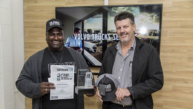 Malcolm Gush, sales director of Volvo Trucks South Africa, presents the winner's trophy to Dharmendra Arejune from Mersey Trading. Arejune will now go on to represent South Africa at the world finals to be held in Gothenburg, Sweden in September this year.