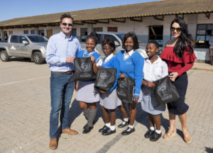 Thomas Schaefer, chairman and managing director of Volkswagen Group South Africa and his wife, Wendy with pupils of Nkululeko Secondary School in KwaNobuhle, Uitenhage when they delivered 2 300 sanitary towels to the girls at this school.
