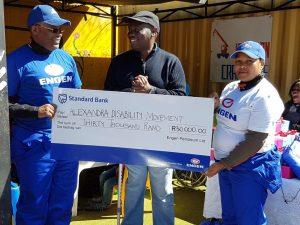 Engen CSI Manager Mntu Nduvane and Engen CSI co-ordinator Thandi Manqana hand over a cheque to ADM founder Jerry Ntimbane