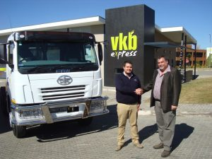 Juan Wiggill (right), dealer principle of FAW Harrismith, congratulates Bryan Boshoff, Logistics Manager of VKB on their new FAW purchase.