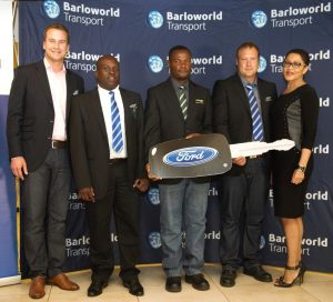 Neil Henderson, CEO of Barloworld Transport (far left), and Ms Thokozile Mabaso (far right), Director of Road Safety KZN Department of Transport, congratulate Barloworld Transport's 2016 Driver of the Year Award's top three drivers: Winner - Cornelius Grobler, runner up - Norest Shonhiwa (centre) and third placed David Maimela.