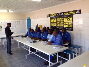 A group of Nick's Motors drivers watching the original video sent to the company by FleetWatch. The video has now become part of the company's standard driver training sessions.