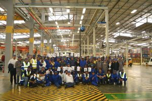 Management and staff of FAW Vehicle Manufacturers South Africa (Pty) Ltd gather to celebrate the 2000th truck built at the Coega plant.