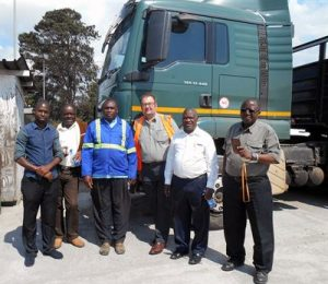 Chris Brook (centre), DHL's Senior Driver Trainer, recently returned from the charity's Professional Driver Training Programme in Malawi.
