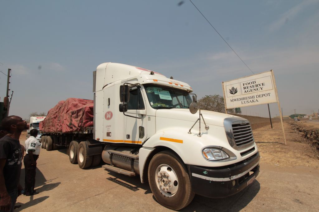 The leading truck exits the gate of the Mwembeshi depot of the Food Reserve Agency in Zambia