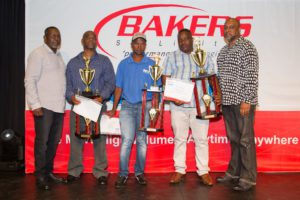 Seen on the Bakers SA Limited 'Drivers of the Year' winners podium are, from left: Ismail Khan (driver trainer manager); Anton Ngcobo (Driver of the Year – Light Link); Amos Konco (Driver of the Year – Pantech); Rodgers Mazibuko (Driver of the Year – Heavy Link); and Nizaam Khan (operations manager)