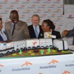 Cutting the celebratory cake are, from left: Wim de Klerk, ArcelorMittal SA CEO; Mathys Enslin, Barloworld Logistics executive; Mlamuli Buthelezi, Transnet Freight Rail; Dr Rob Davies, Minister of Trade and Industry; Bongiwe Ntuli, Grindrod Freight Services; and Rajendra Balmakhun, Newlyn Investments.