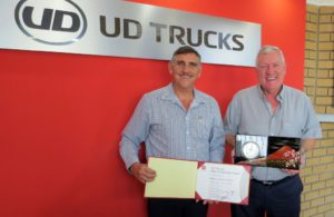 Gert Swanepoel (left), managing director of UD Trucks Southern Africa, celebrates the company's International Sales Award with Peter English, chairperson of the UD Trucks Dealer Council.