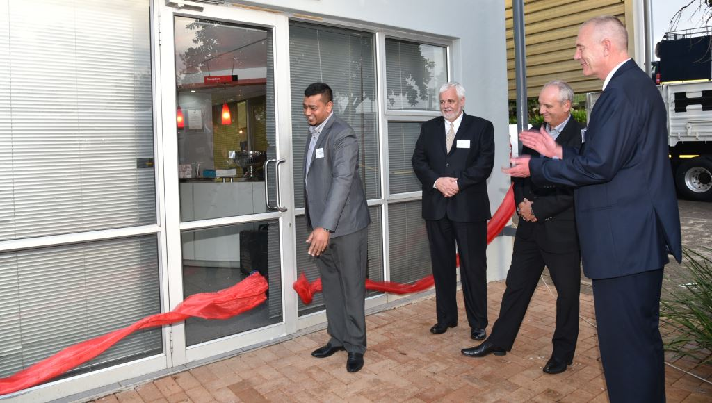 Avashan Govender, Imperial Hino Franchise Director, cuts the ribbon marking the official opening of the Hino Pomona dealership. Looking on are, from left: Calvyn Hamman, Toyota SA Senior Vice President, Sales and Marketing; Ernie Trautmann, Hino SA Vice President; and Gert Koekemoer, managing director of the Imperial Commercial Vehicle Division.
