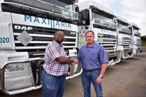 "Bernard Lunga (left), managing director of Maxillaria Logistics, takes delivery of the 10 new DAF XF105.460 units from Piet Kemp, sales executive of Babcock DAF. ""Given how well the business has done since we started last year, our strategy has been to grow the fleet to give us better capacity to go after more work. With the new DAF additions, we are well on our way to achieving this,"" says Lunga."