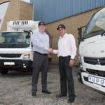 Frans Putter (left) from Mercedes-Benz Commercial Vehicles Centurion hands over two of the six FUSO models to Johan van Zyl, national distribution manager for Anchor Yeast.