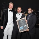 Jasper Hafkamp, executive director for Daimler Trucks and Buses southern Africa, hands Enrico Botha, dealer principal for John Williams Motors, the award for Dealer of the Year, Best Sales Performance for FUSO. On the right is Ziyad Gaba, head of FUSO Trucks Southern Africa.