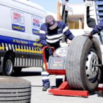 Service technicians demonstrate wheel balancing on the state-of-the- art balancing machine that comes with the TruckForce Mobile Van. Each van provides trained personnel and the equipment necessary to take care of any tyre-related situation.