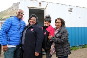 Working together to bring some relief to local residents are, from left: Rowlands Peters, head of FleetBoard South Africa; Melissa Dolan, Training and Marketing Officer for the Red Cross; Levoan van Aarde, Provincial Manager for the Western Cape/Northern Cape and Operations & Disaster Manager for the Red Cross, National; and Margaret Morris, Corporate Social Responsibility Specialist for MBSA).
