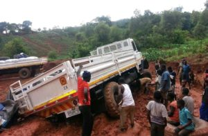 The Malawi operation was certainly not one for the feint hearted. The decision by Imperial Logistics to use the legendary Samil vehicles paid off when the rains started in Malawi and many of the lighter trucks came to a halt in the muddy conditions. As this picture shows, it was pretty difficult even for the Samils but they all got through and delivered the essential food aid to the recipients.