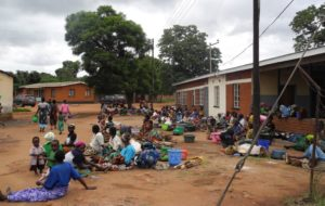 "Patients outside a healthcare facility in Malawi where solar panels have been installed. ""This solar initiative aims to ensure the seamless delivery of healthcare services in the face of prolonged power outages that the country is currently experiencing,"" says Heinrich Strauss, managing director at Resolve"