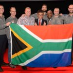 Lafras Kruger and Buza Ngcelwane (centre) and the rest of the UD Trucks Southern African support team, with Kishi Nobuhiko, UD Trucks' senior vice president of brand and product, celebrate the fantastic achievements of our two local drivers in the UD Trucks Global Extra Mile Challenge.