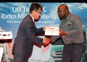 Buza Ngcelwane, receives his award for the Best Fuel Efficiency in the Quon product category from Kishi Nobuhiko, UD Trucks' senior vice president of brand and product. Yeah Buza!