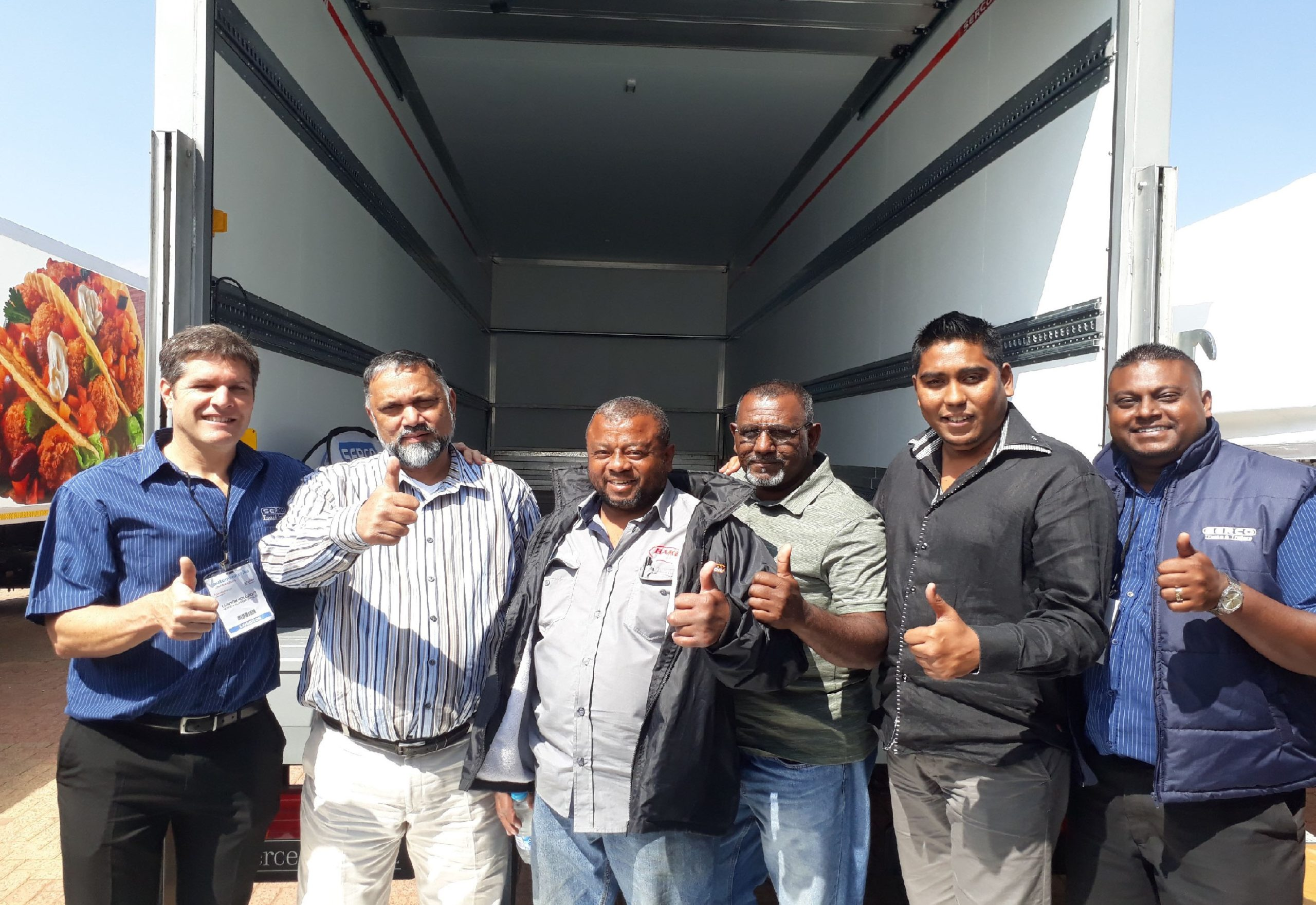 Seen at the handover of the new Bakers SA Ltd vehicle are from left: Clinton Holcroft from Serco with Aman Kader, Farouk Bhadu, Ismail Khan, Mohammed Noushad Cassim and Trivolan Pillay from Bakers.