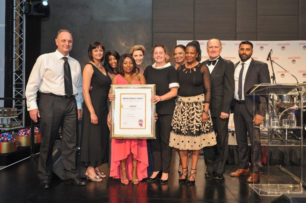 Unjani award: Johnson & Johnson and the Unjani team receiving their Gold Award at the American Chamber of Commerce's 'Stars of Africa' awards ceremony.