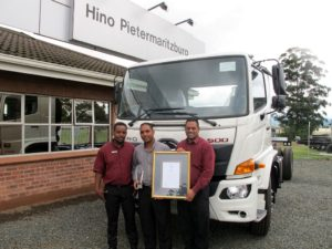 Pretesh Singh (centre), the dealer principal at Hino Pietermaritzburg, is flanked by his service manager, Siya Nzimande, and parts manager, Nathaniel Balliram, as they proudly display the awards received for winning the commercial vehicle category in the NADA/Sewells-MSXI Business of the Year contest.