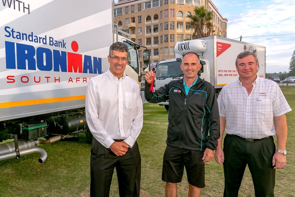 Paul Wolff (centre), Ironman Africa's director of operations, takes delivery of eight refrigerated Isuzu trucks which were used at the water points during the Standard Bank Ironman African Championship last weekend. With him is Michael Sacke (left), CEO and managing director of Isuzu Motors South Africa and Duncan Young, Isuzu Truck Centre Port Elizabeth dealer principal.