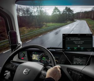 When a Volvo truck receives a signal about a hazardous situation on the road, a warning message appears in the instrument panel. This alert allows the driver to reduce speed, adjust the vehicle's progress to current traffic, and avoid a collision.