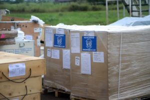 WHO medical supplies to combat the Ebola virus are seen packed in crates. The difficulties faced to get the Ebola vaccine where it is needed without delay and without compromising its effectiveness are making global headlines because they relate to one of the world's most deadly, high profile diseases.