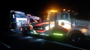 After some 65 drivers had been arrested in the evening, Joey's Towing was called in to remove the trucks parked across the highway and then - along with some other tow companies - continued moving trucks throughout the night so as to open the road.