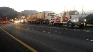 The sun is rising and the trucks – left standing after the drivers were arrested - are still being moved to open the road on the south bound lane.