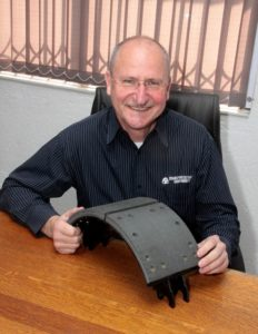 "Transportation Components' sales manager Patrick Bruinette, holding a Duraline brake lining. ""Opting to purchase the most economical product may not be the most financially prudent decision."" In other words, don't go on price alone as it could bite your pocket in the long run."
