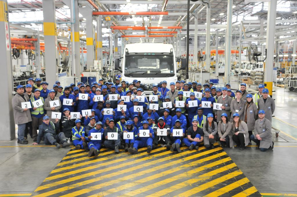 FAW Management and staff gather to celebrate the assembly of the 4 000th FAW unit at FAW South Africa's Coega assembly plant.