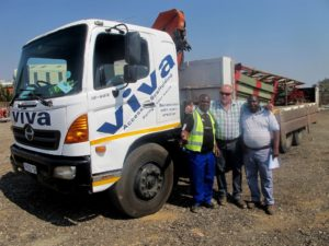 Adrian Nunn, one of the founders of Viva Access Scaffolding and now sole owner, with driver Nathaniel Muvhango (left) and yard manager David Mkwananzi (right) with the stalwart Hino 15-258.