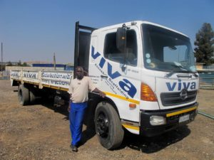 Driver Clarence Madau in front of the second Hino 15-258 run by Viva Access Scaffolding. Between this and the other unit, more than 100 000 tons of steel scaffolding have been transported over the past 12 years.