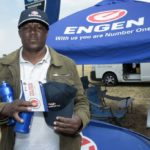Truck Driver Richard Kabelo goes away with peace of mind and an arm full of goodies after completing his heath check during the Engen Driver Wellness campaign.