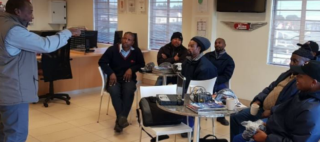 Hino SA driver trainer Joseph Peme (left) giving feedback to drivers from OK Bazaars, Bloemfontein, and Cosmetics after their orientation and evaluation sessions.