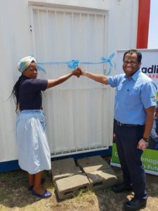 It was a happy day for Nomaswazi Khubeka, principal of Siyathanda Creche, when she cut the ribbon to the refurbished shipping container with SRSA factory director (Ladysmith) Udaiyappan Ulagappan.